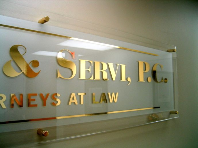 Law Firm Lobby Sign - gold film letters with clear acrylic/etched vinyl backing    Like this Interior Office Lobby Sign for your Reception Area or Interior Accent Wall?  Contact us to find out how we can design and manufacture one for your interior lobby.  You can either fill our quote form @ www.saifeesigns.net or call us at 1-888-TX-SIGNS / 713-263-9900.