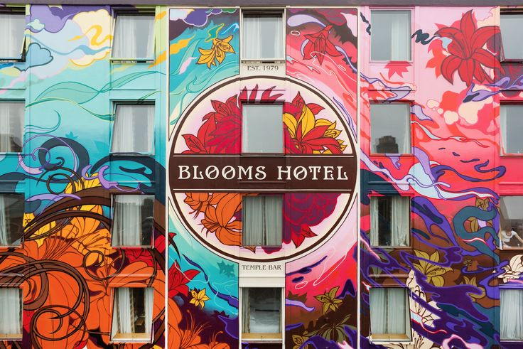 Blooms Hotel, Temple Bar, Dublin. James Earley painted Blooms Hotel over a period of 8 months 2013-2014. Taking a cue from the name of the hotel, he decided to visualise the story of James Joyce's novel Ulysses, using the hotel's entire exterior to do so.  www.inputout.com  www.facebook.com/jamesearleyart www.instagram.com/james_earley    Photo credit: www.eoinholland.com #Blooms #Hotel #Graffiti #Street #Art #Ireland #Irish #James #Earley #Spray #Paint #Mural #Signage #Typography #Urban