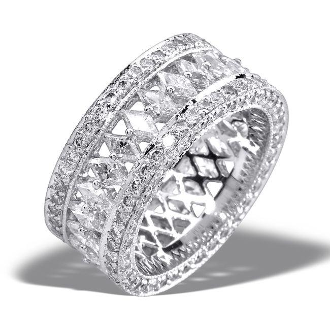 "Twenty-five year anniversary ring: middle row; twenty-five custom cut ""diamond shaped"" diamonds   Side rows: bead set round brilliant diamonds"