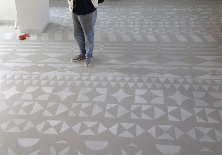 Painted pattern on floor. A metal mask was used to create this stamped concrete floor.