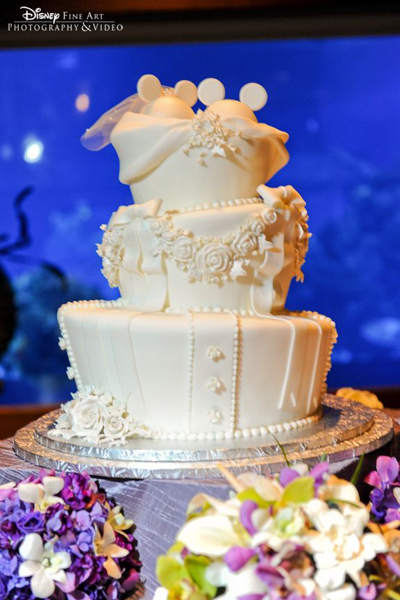 All white wedding cake with white chocolate bride + groom Mickey ears cake topper