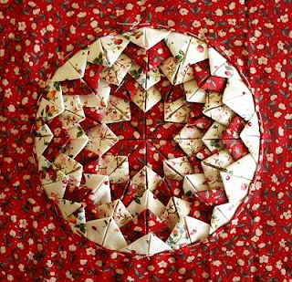 Great instructions- these are so fun to make.  I finished off the edges of the round with lace.  So pretty!