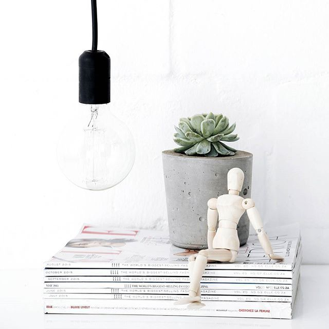 Not only do we work with cement designs but we work with lighting designs too. This one shows our portable light pendant in black.