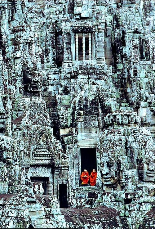 Angkor Thom Monks, Cambodia. Angkor Thom, located in present day Cambodia, was the last and most enduring capital city of the Khmer empire.