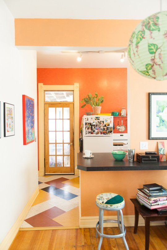 You can see a daring orange wall paint color option and a more subdued one in the same house: Jenna's Colorful Colonial Reno. Porter Paints Rustic Pottery for the bold; Porter Paints Carrot Cake for the slightly more shy.