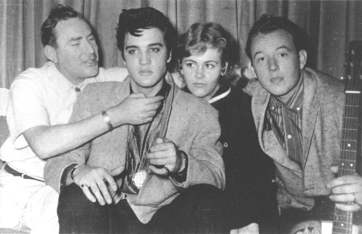Elvis with his friends, deejay Dewey Phillips on the left and Bonnie and Charles Underwood on the right. This picture was taken in Charles and Bonnie Underwood's apartment at Holiday Towers in Memphis, TN in the evening of April 15, 1957. See more at: http://brian56.dk/50s/1957/5704/570415.html