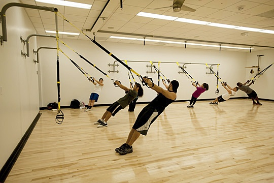 Students get pumped in the determination studio using trx