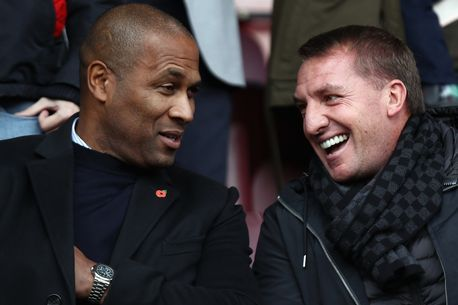 Les Ferdinand (l) chats to Brendan Rodgers