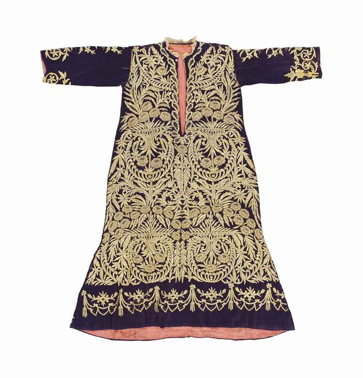 A GOLD-EMBROIDERED PURPLE VELVET WEDDING ROBE OTTOMAN TURKEY, 19TH CENTURY With gold thread, the recurring pattern composed of a palmetted quatrefoil within a roundel surrounded by a floriate garland, lined 50½in. (128cm.) across