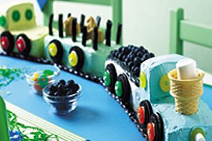 What's a train party without a train cake--incomplete. So if you're on the hunt for some train birthday party ideas for cakes, here's a fun option.