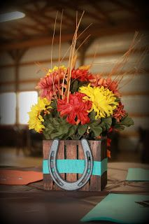 I added ribbon and a mini cast iron horseshoe to little wooden flower arrangements I found at Walmart. Tied in nicely with our little western wedding!
