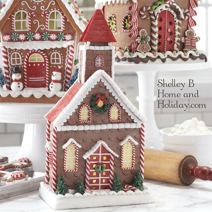 Gingerbread church Christmas decoration.  Made of claydough with red candy roof.   A Christmas wreath hangs from the peak and windows and doors are trimmed with red and white peppermint sticks. Available at Shelley B Home and Holiday.com