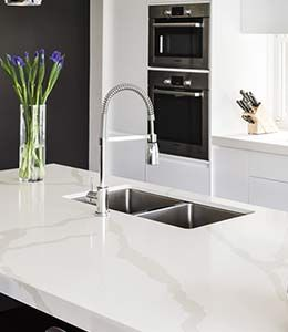 I really like the look of this smartstone carrara countertop. It has such a clean aesthetic to it. I wonder how its durability compares to granite.