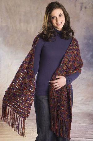 Use super fine yarn and this easy crochet pattern to create a pretty and delicate lace stole with fringe. Wrap up in this crochet stole all winter long or use it as a scarf throughout the cold months.