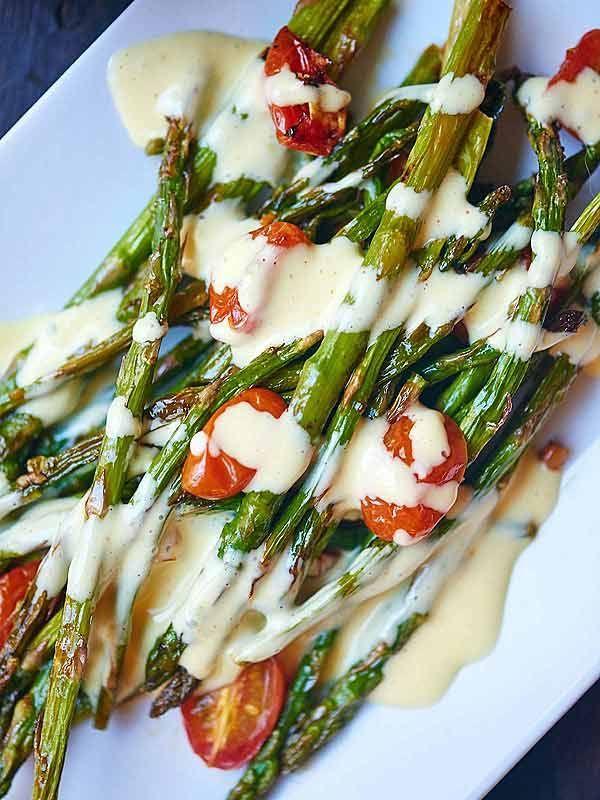 This roasted asparagus and tomato with lemon garlic hollandaise is a truly simple & elegant dish. Crisp asparagus. Juicy tomatoes. Creamy hollandaise. Yum! showmetheyummy.com