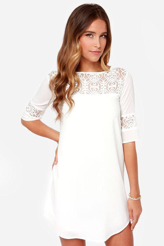 """Our head is in the clouds over the dreamy style of the BB Dakota Devera Ivory Lace Shift Dress! Swirling lace appliques adorn the yoke with rounded neckline and half sleeves decorated in bands of more lace. Woven material creates a flattering shift shape ending in a rounded hem at bottom. Woven lining. Model is 5'8"""" and is wearing a size X-small. Self: 100% Polyester. Lace: 61% Cotton, 39: Nylon. Polyester lining. Hand Wash Cold."""
