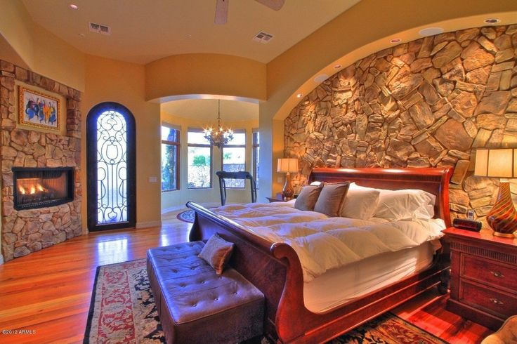 Mediterranean Master Bedroom with Ceiling fan, Hardwood floors, Alpine Furniture Louis Philippe II Sleigh Bed, French doors