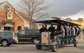 The human-powered Cycle Pub passes the Deschutes Brewery pub in downtown Bend. Passengers can sip beer while they pedal the vehicle, which stops at craft breweries around town.