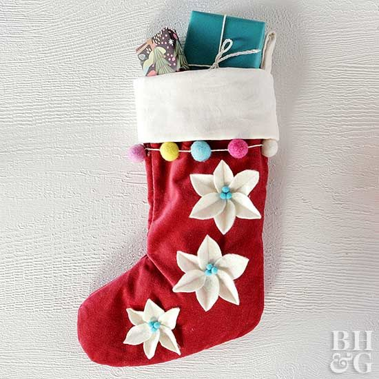 Bold poinsettia blooms are the star of this handmade Christmas stocking.