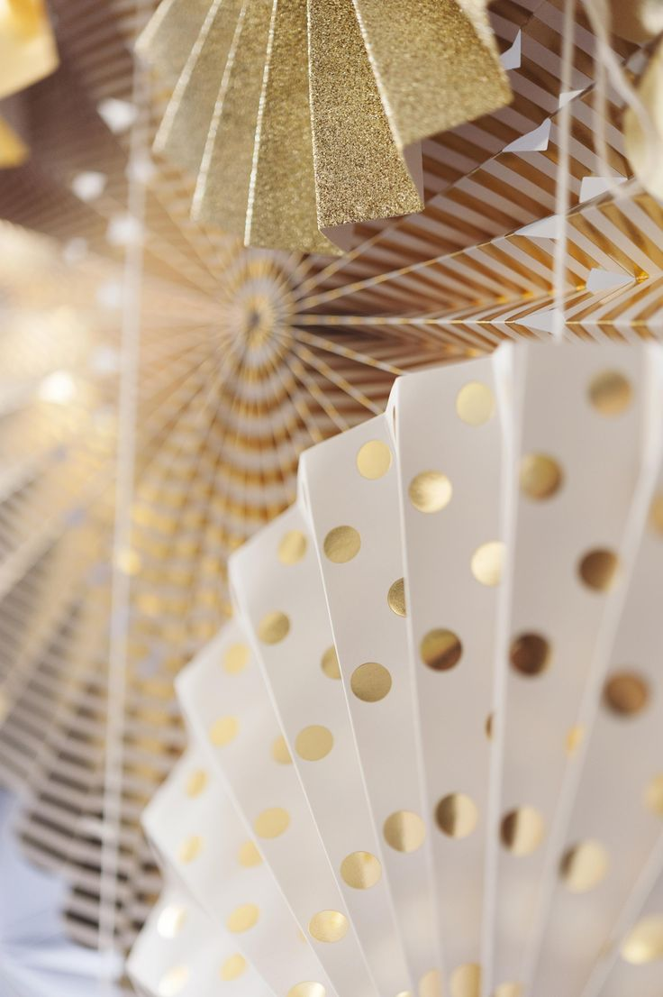 At Last | We love these gold pinwheel decorations. Perfect for hanging or as a photobook backdrop!