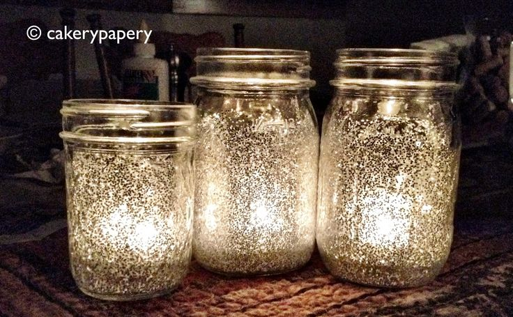 Just make a glue wash (glue + water) and brush the inside of the mason jars. Add glitter of your choice (I like silver) to the inside of the jars, and roll/spin the jar around until the glitter coats the sides. Let dry and add a tea light.