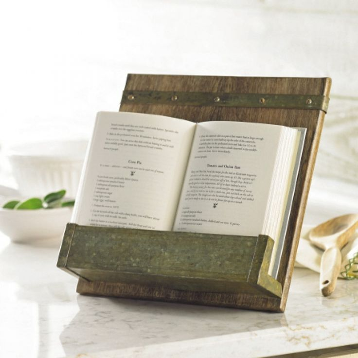 Perfect for any rustic kitchen or vintage lover, this rustic cookbook holder is made from mango wood and features a galvanized metal tray and rustic bolts detailing.