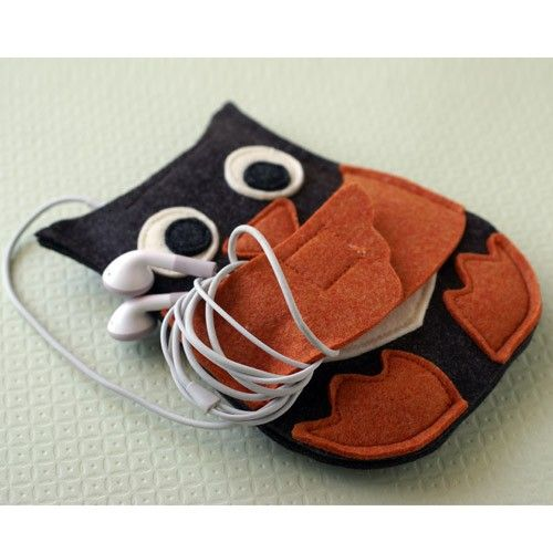 Owl iPod case: the arms open up to hug your headphones. This is unfairly adorable.