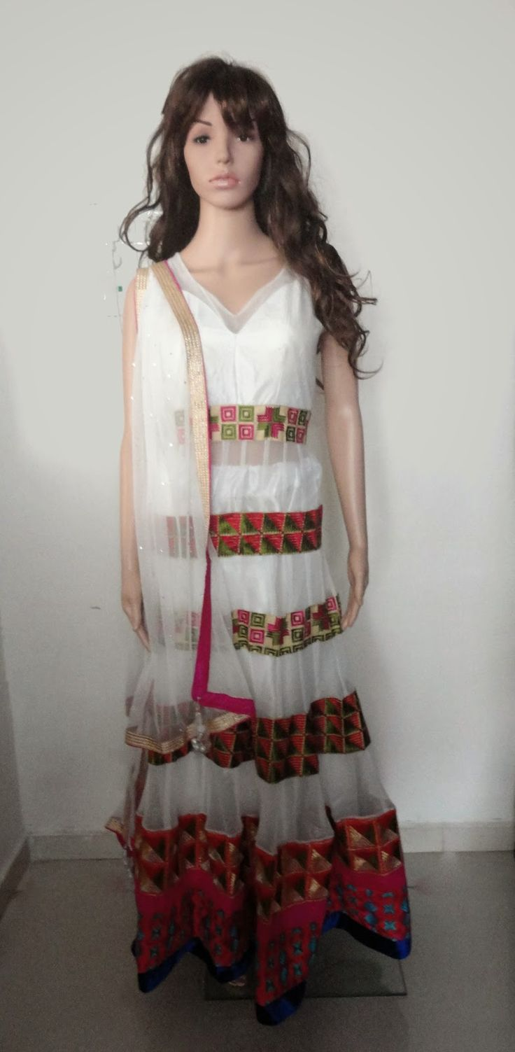 http://www.fashion4style.com/woman/clothing/bollywood-replica/white-designer-lehnga/pid=NjY=