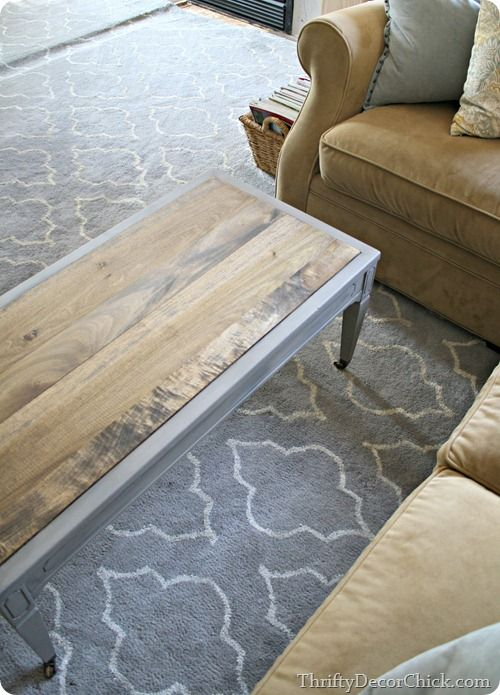 I took this coffee table from drab to fab by adding wood for Wood plank top coffee table