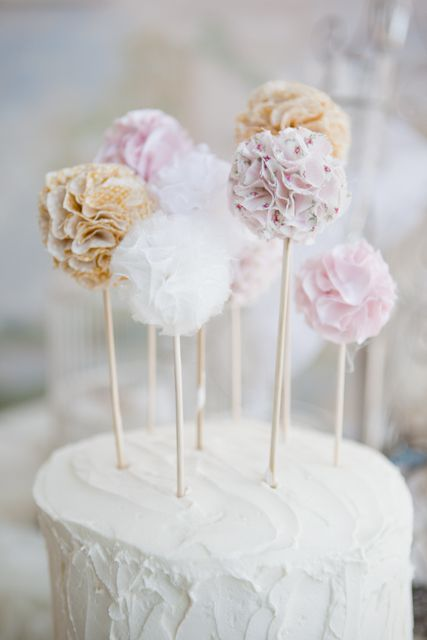 An adorable cake topper & I love the texture of the icing. White and simple, yet rustic from the texture.