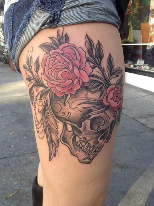 Skull and flowers thigh tattoo