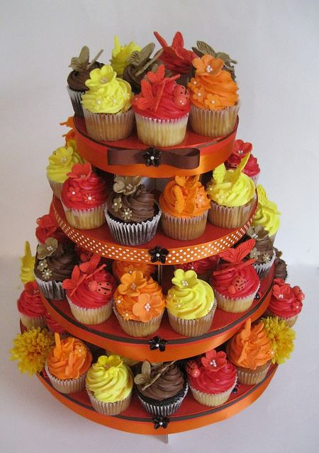 Fall Wedding Cupcake Tower-ok not this one beause its ugly but would be a cute idea to do for you instead of a cake I bet those cupcake tower things don't cost much and each layer can be a different flavor cupcake could be fun