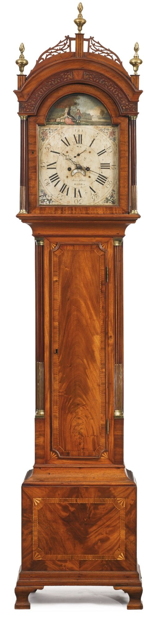 The Important Asa Stebbins Federal Inlaid and Figured Mahogany Tall Case Clock, works by Aaron Willard (1757-1844), painted dial probably by John Minot (w. 1793-1826), case attributed to Stephen Badlam Sr. (1751-1815), Boston, Massachusetts, circa 1800 Retains its original flanking ornate cast brass finials. Height 104 3/4 in. by Width 22 in. by Depth 12 in. [sold for $185,000]
