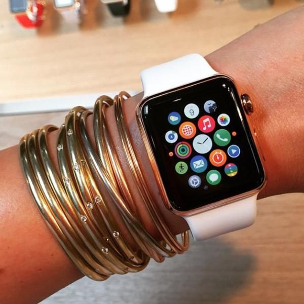 How 12 Fashion Insiders and Celebrities Style the Apple Watch - Blogger Ilkem Ozturk wearing the a=Apple watch with gold bangles