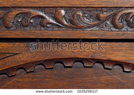 Ornate antique wood carving detail.