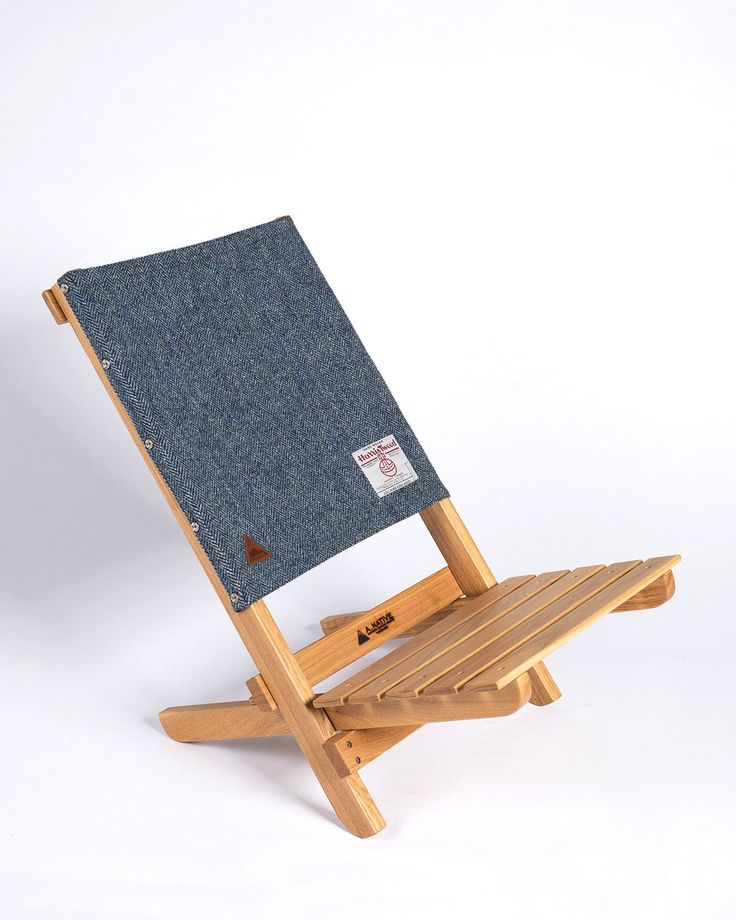 Traditionally wovenwool, hardwood, and simple design combine in the minimal, comfortable low-slung Lounge Chair. Folding camp chairs are rarely eye candy,