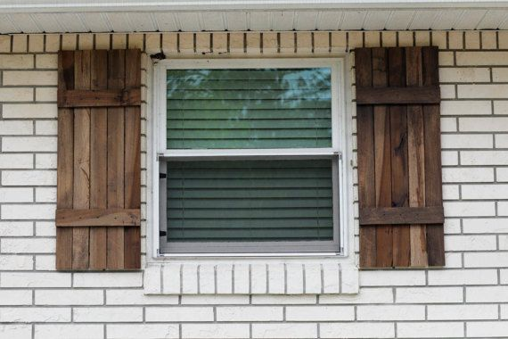 The rustic farmhouse exterior shutters shown here are made from salvaged poplar wood and are stained with Sherwin-Wiliiams SuperDeck Log Home & Deck Stain in Hill Country. The dimensions of the shutters in photos are 15in width & 39in height. Price listed is for ONE pair (2) shutters.