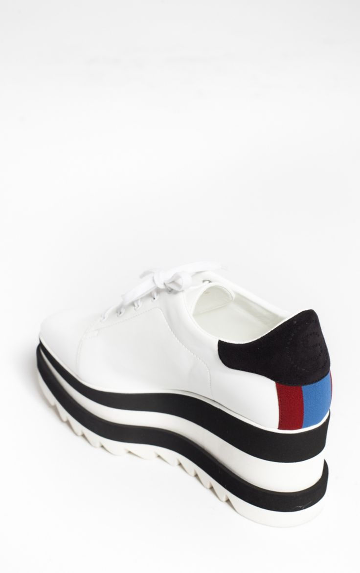 Black and White Sneak-Elyse by Stella McCartney These New sporty twist on a classic - The Sneak-Elyse in contrasting black and white. Featuring chunky rubber saw-edge sole.