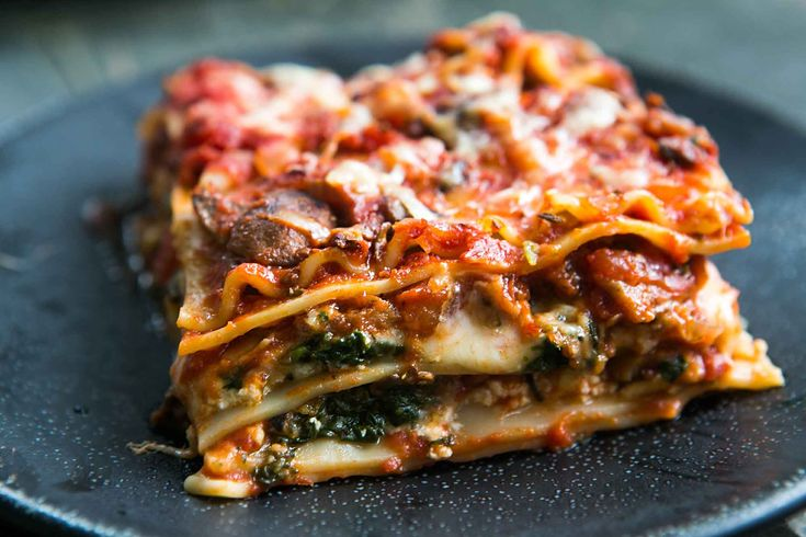 Vegetarian lasagna with spinach, mushrooms, ricotta, Mozzarella, and pecorino cheeses. So good! Great vegetarian alternative for holiday meals.