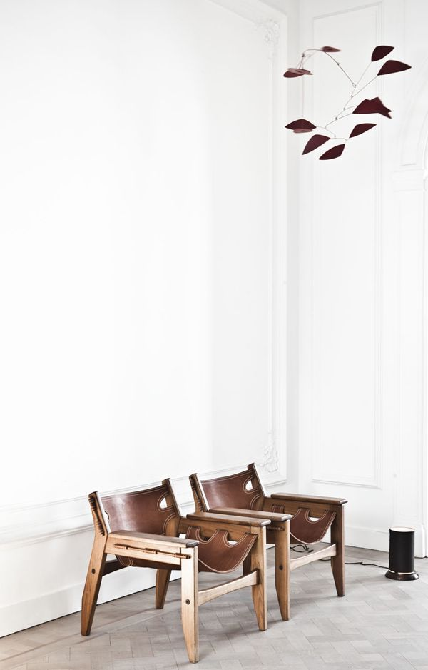 wooden and leather sling chairs