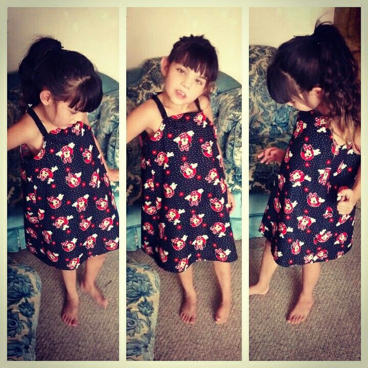 Sundress in an adorable minnie mouse fabric. Simple, comfy, super cute. She loves it..