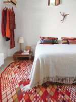 8 Cool Bedside Table Solutions Beyond The Dull Nightstand #refinery29  http://www.refinery29.com/dwell/14#slide-5  Thanks to Matthew Hufft, their envelope-pushing architect and longtime friend, Hannah and Paul Catlett have a new home in southwestern Missouri that's a fresh, unconventional take on the traditional farmhouse. He built the walnut bed and nightstands in the master bedro...