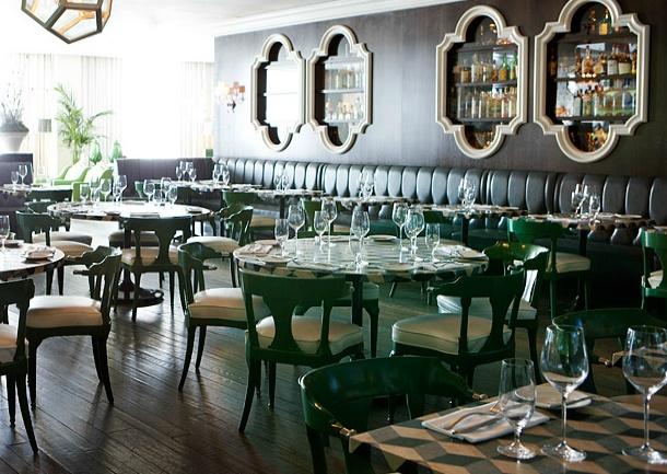 Restaurant. Green. Black. White. Lacquer Chairs. Arched Moroccan Interior Windows. Geometric Pendant.