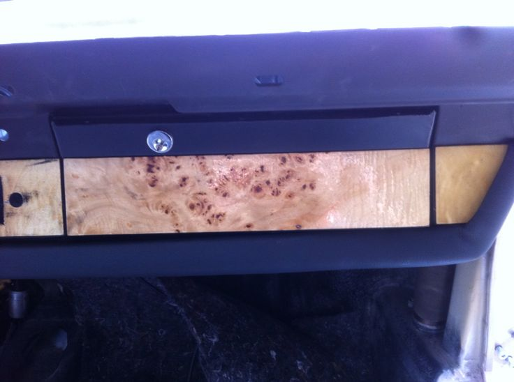 Glovesbox with a wood cover..