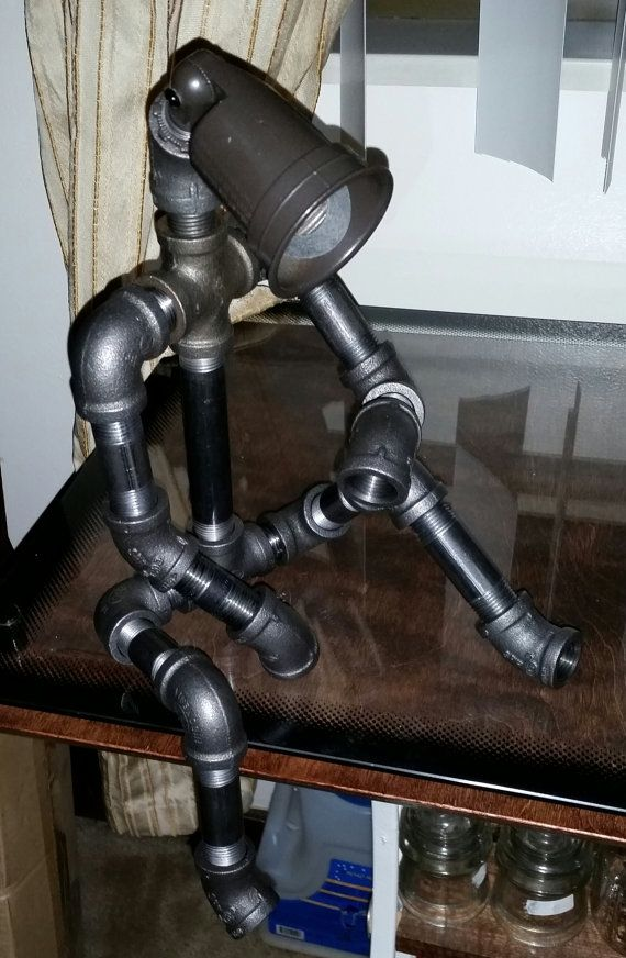 Hey, I found this really awesome Etsy listing at https://www.etsy.com/listing/214757482/robot-light-modern-industrial-cast-pipe