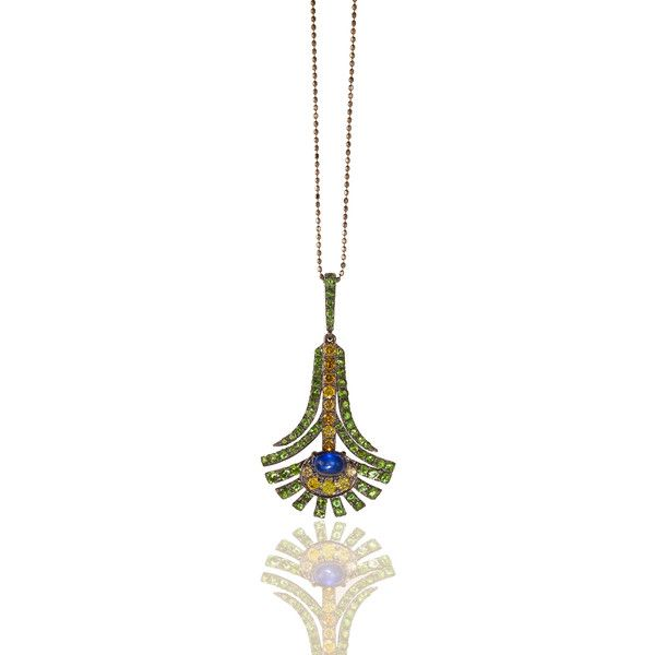 This pendant is inspired by the natural beauty of peacock glory feathers. Basic lines made from 18K white rhodium gold and set with intensive colorful stones. 1 blue 0.86ct sapphire, 13 yellow diamonds which constitutes 0.50ct and 63 green garnets of a total 1.45ct. Perfect for day wear as well as for a night out.