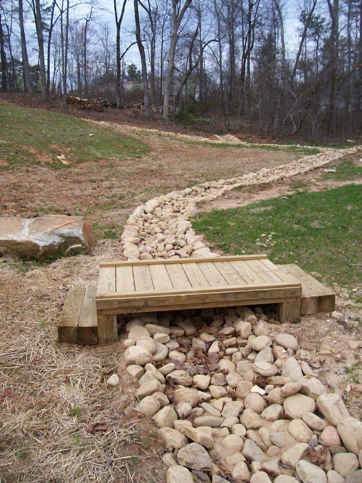 River Rock Creek Bed with wooden step bridge.  Dahlonega, GA