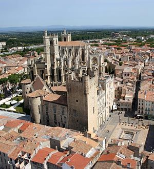 Narbonne (French pronunciation: [naʁ.bɔn]; Occitan: Narbona; Latin: Narbo) is a commune in southern France in the Languedoc-Roussillon region. It lies 849 km (528 mi) from Paris in the Aude department, of which it is a sub-prefecture. Once a prosperous port, it is now located about 15 km (9.3 mi) from the shores of the Mediterranean Sea. It is marginally the largest commune in Aude, although the capital is the slightly smaller commune of Carcassonne.