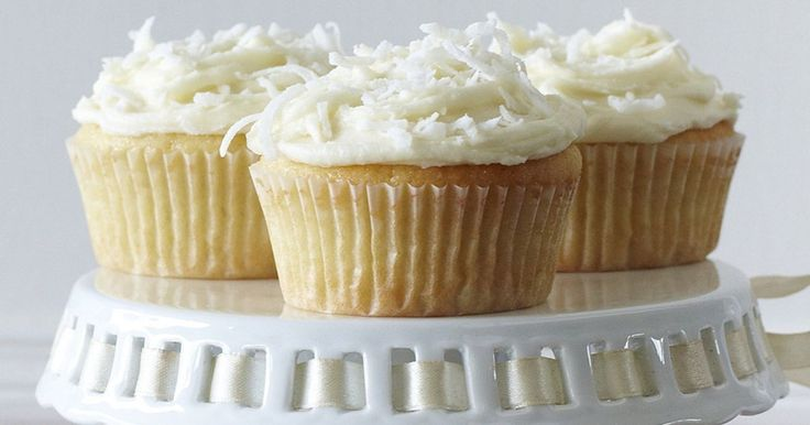 Add some zest to your afternoon with these tasty lemon coconut cupcakes.
