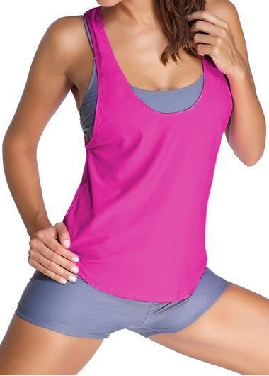 Fuchsia Task Sports Bra Tankini Swimsuit With Grey Boy shorts. The Tankini Swimsuit features two looks in one. Go from your daily run to SUP with a removable tankini and sport bra.